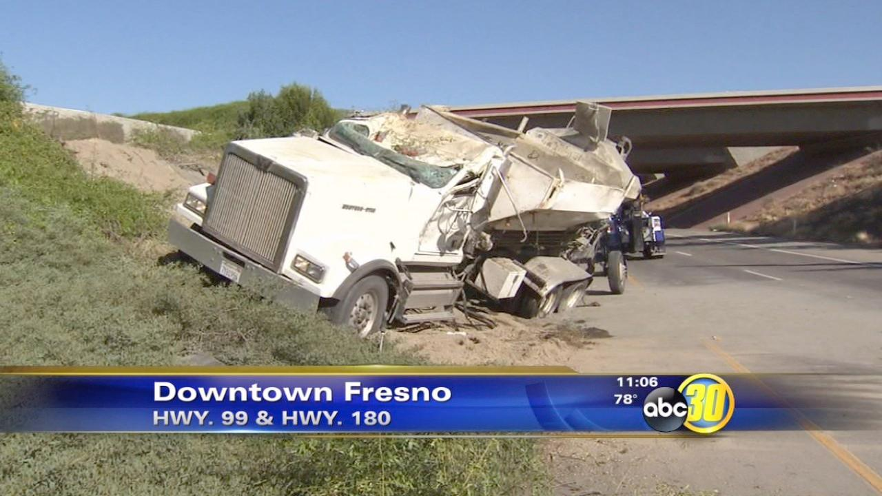 Cement truck overturns on HWY 99 to HWY 180 interchange