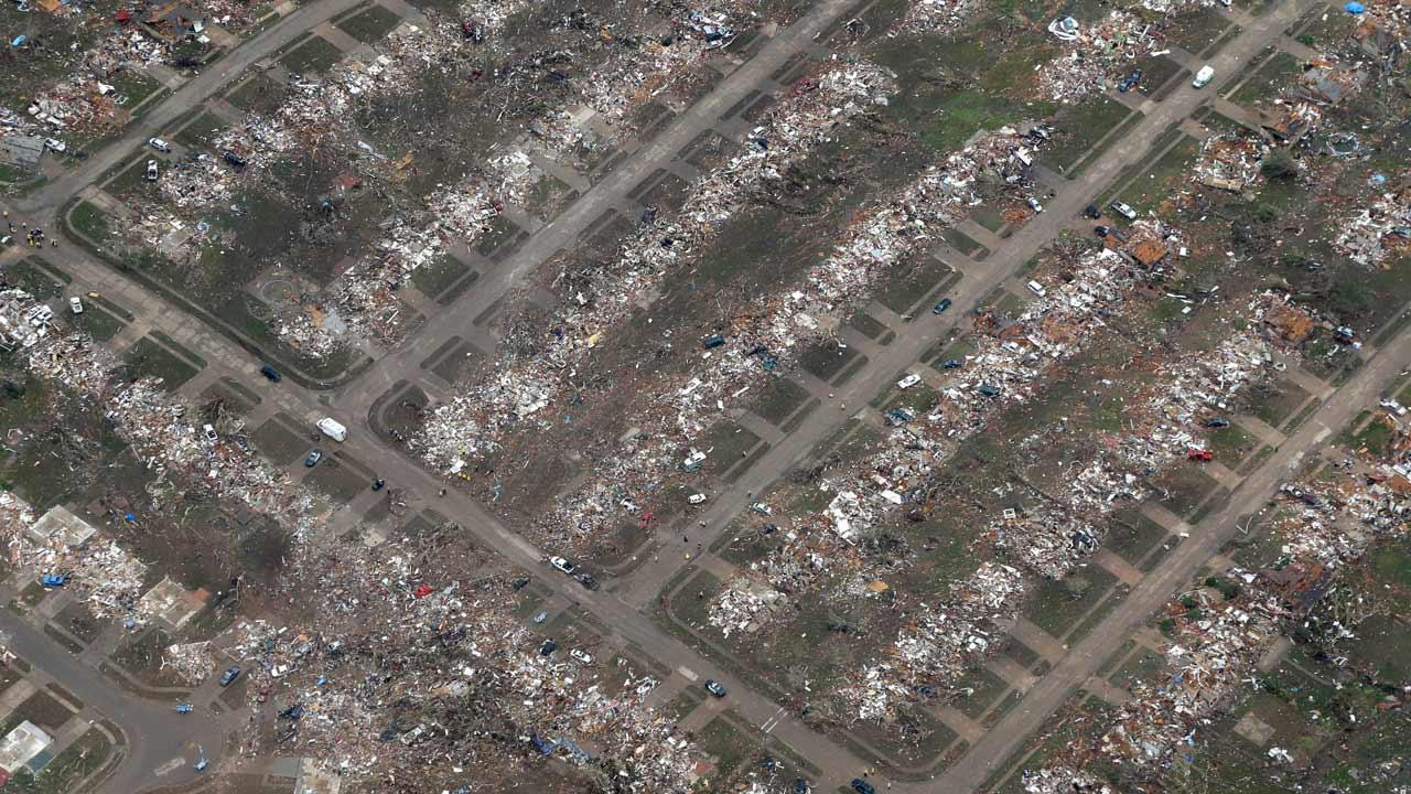 An aerial view of an entire neighborhood destroyed by Mondays tornado is shown Tuesday, May 21, 2013, in Moore, Okla.
