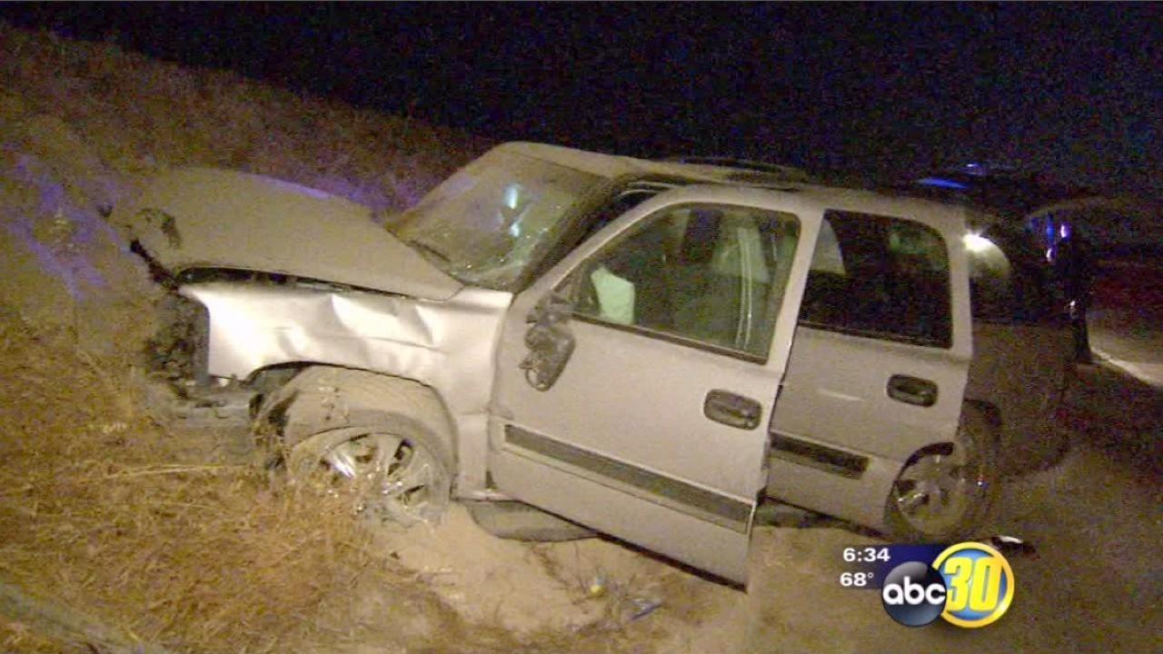 Fresno police say a car jumps 2 freeway lanes, median, before crashing