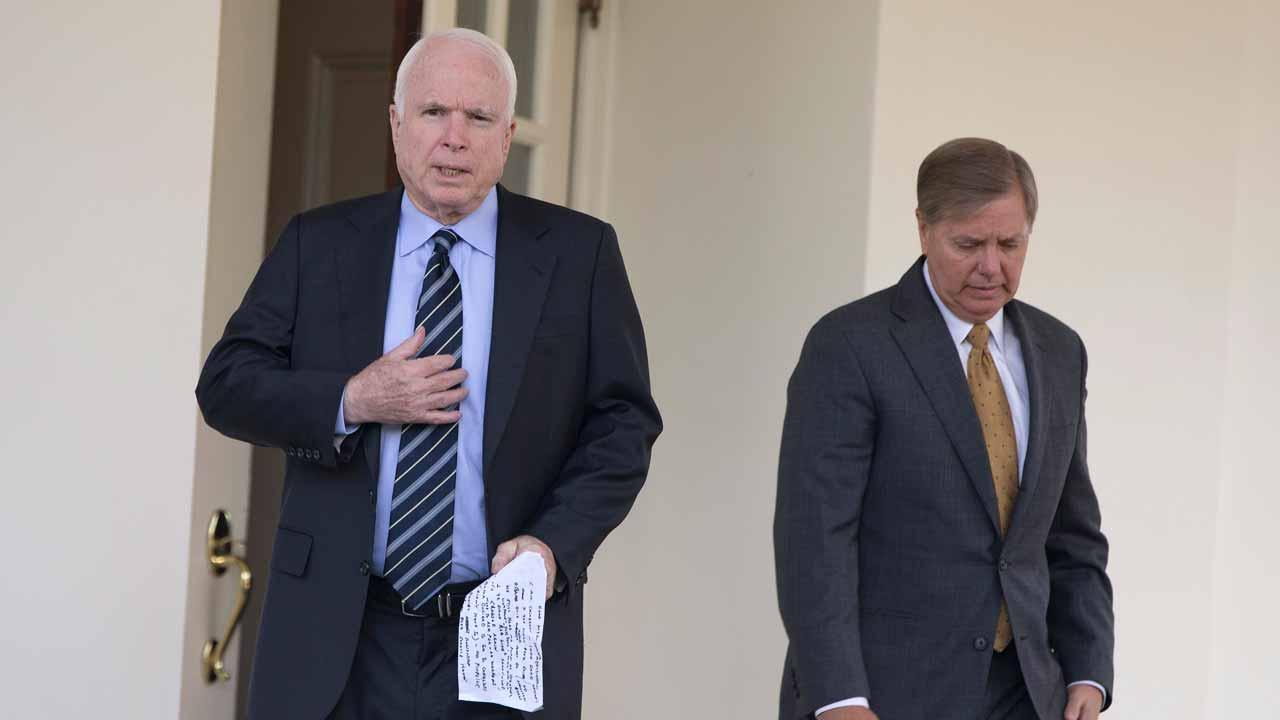 Sen. John McCain, R-Ariz., left, and Sen. Lindsey Graham, R-S.C., leave the White House in Washington, Monday, Sept. 2, 2013, to speak with reporters following a closed-door meeting with President Barack Obama to discuss the situation with Syria. President Barack Obama, working to persuade skeptical lawmakers to endorse a U.S. military intervention in civil war-wracked Syria, hosted the two leading Capitol Hill foreign policy hawks for talks and directed his national security team to testify before Congress in a determined effort to sell his plan for limited missile strikes against Syrian President Bashar Assads regime. (AP Photo/Evan Vucci)