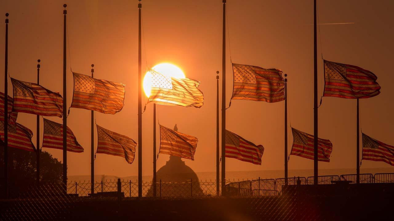 The American flags surrounding the Washington Monument fly at half-staff as ordered by President Barack Obama following the deadly shooting Monday at the Washington Navy Yard, Tuesday morning, Sept. 17, 2013, in Washington.