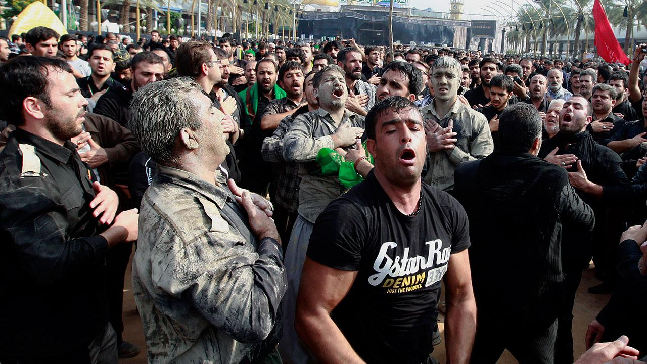 hiite faithful worshippers beat themselves as a sign of grief for Imam Hussein during Muharram