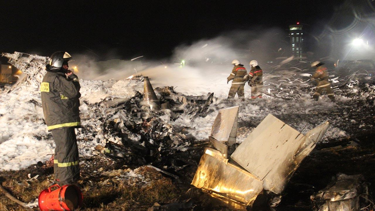 In this photo provided by Russian Emergency Situations Ministry fire fighters and rescuers work at the crash site of a Russian passenger airliner near Kazan, the capital of the Tatarstan republic