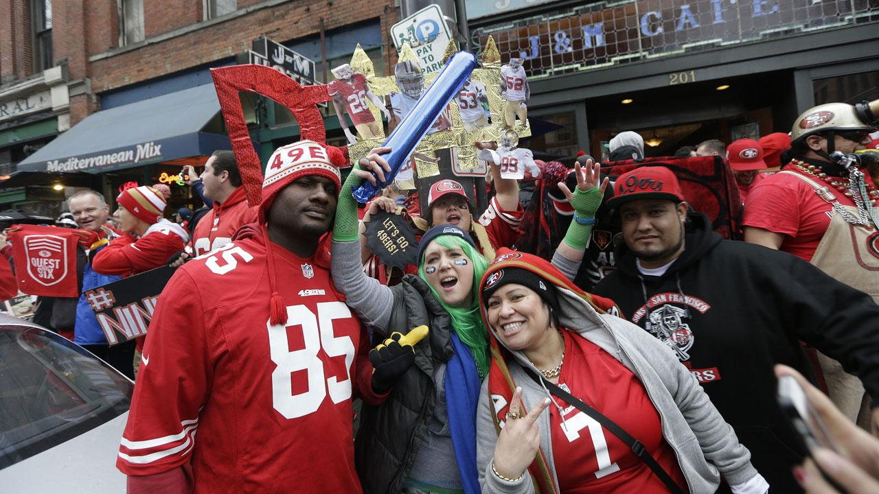 Fans cheer before the NFL football NFC Championship game between the Seattle Seahawks and the San Francisco 49ers Sunday, Jan. 19, 2014, in Seattle. (AP Photo/Marcio Jose Sanchez)