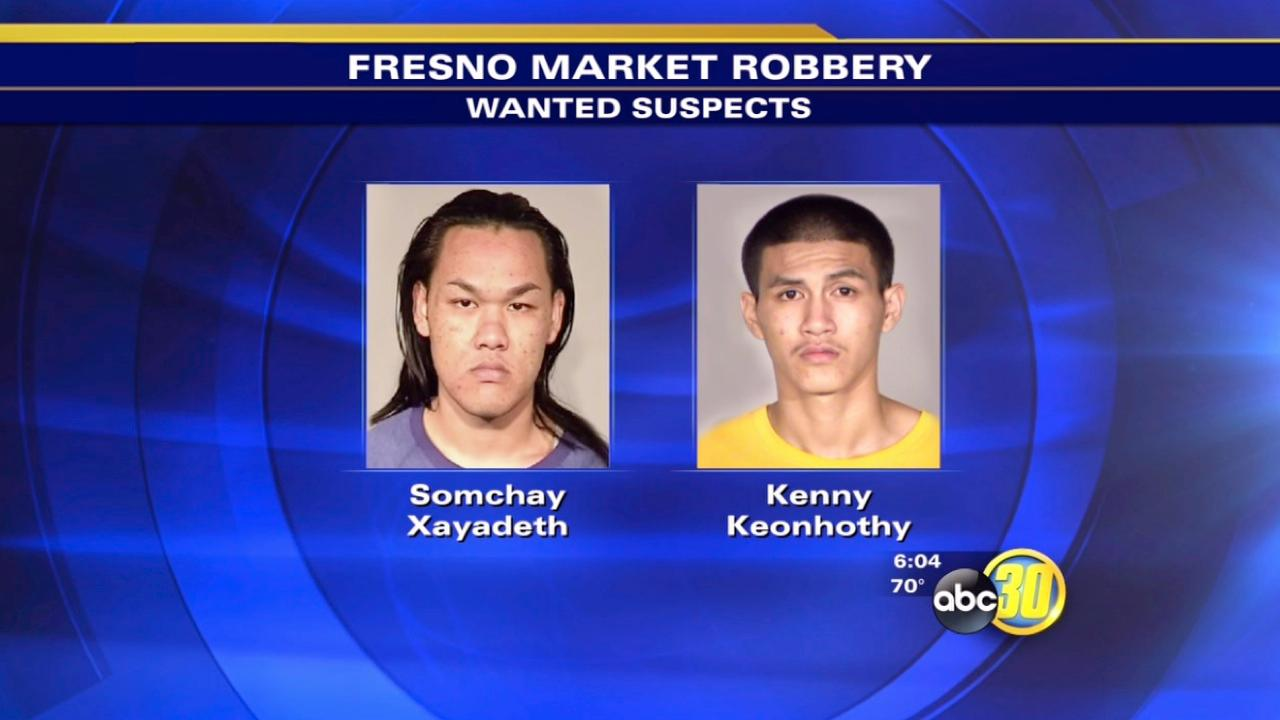 Police identify two wanted robbery suspects