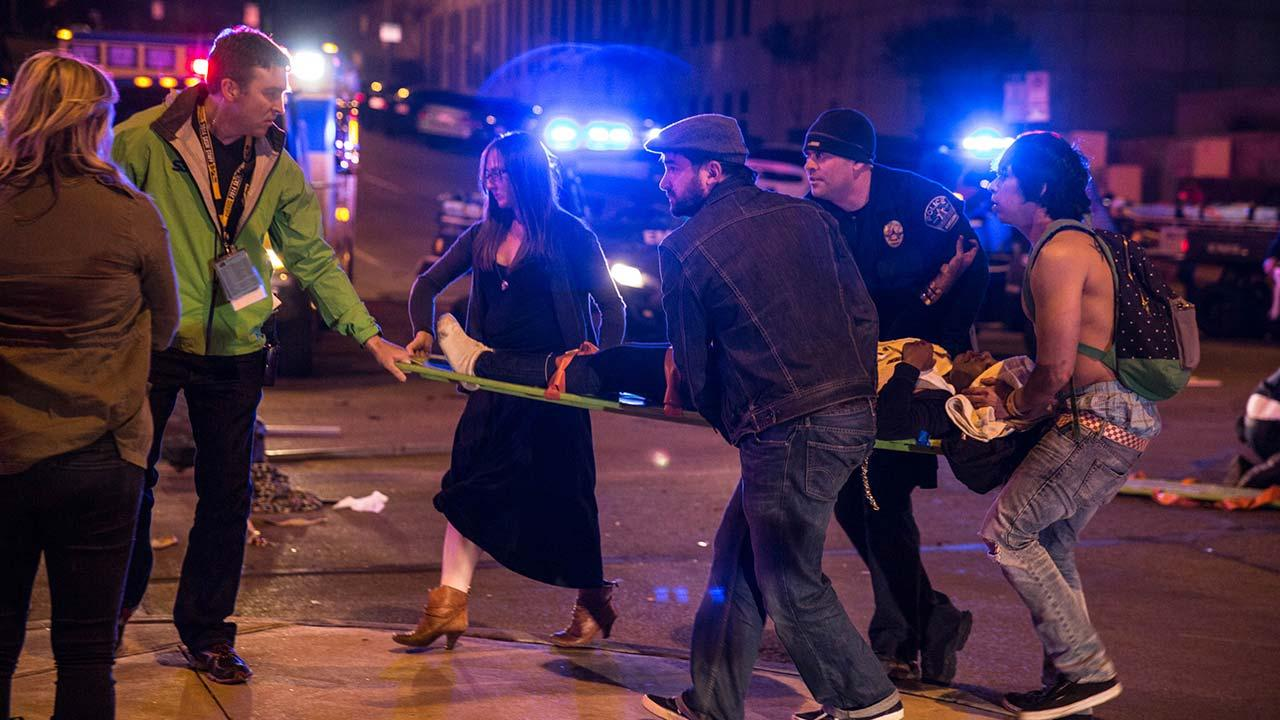 Bystanders assist first responders at the scene at SXSW festival in Austin, TX early Thursday morning March 13, 2014