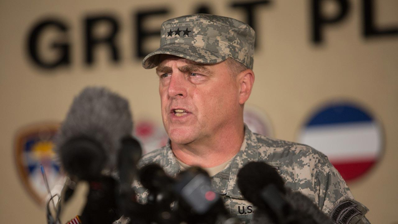 Lt. Gen. Mark Milley, the senior officer on base, speaks with the media outside of an entrance to the Fort Hood military base following a shooting that occurred inside