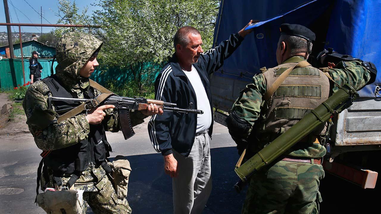Pro Russian armed militants inspect a truck near Slovyansk, eastern Ukraine