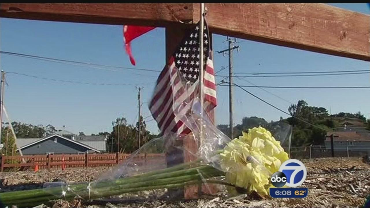 flowers and flag left in San Bruno at site of PG&E explosion