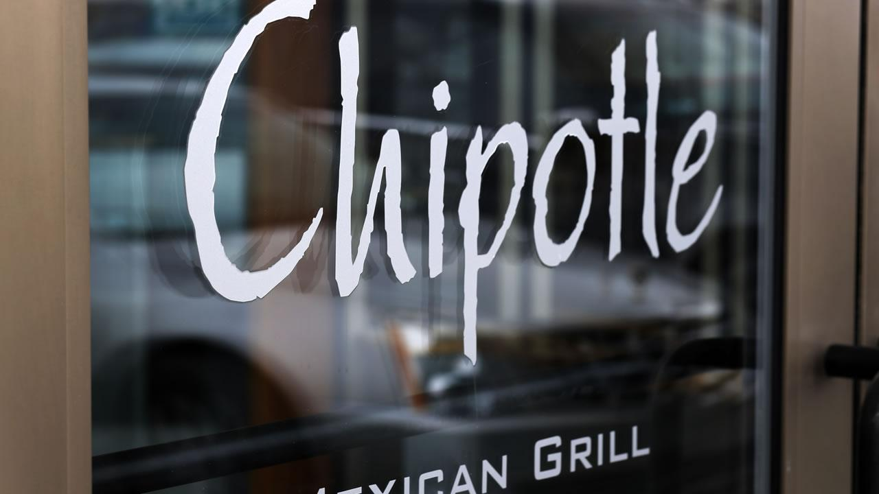 This Tuesday, Jan. 28, 2014, photo, shows the door on a Chipotle Mexican Grill in Robinson Township, Pa.