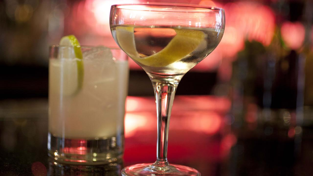 An Agave Margarita and gin Martini made by mixologist Jacques Bezuidenhout sit on a bar in the Starlight Room of the Sir Francis Drake Hotel in San Francisco.