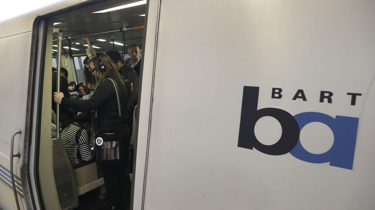 Bay Area Rapid Transit passengers wait for a BART train to depart. Officials say a University of California, Berkeley, student infected with measles could have exposed thousands of others by attending classes and riding public transit.