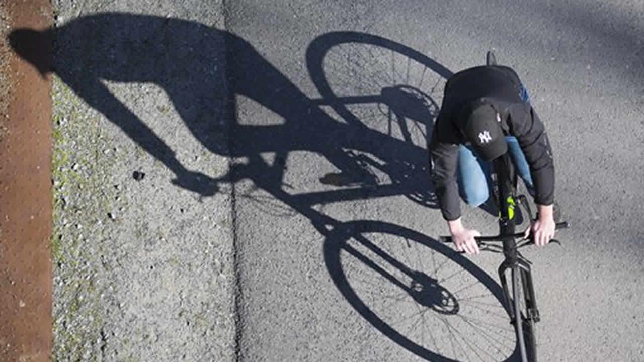 A man rides his bicycle