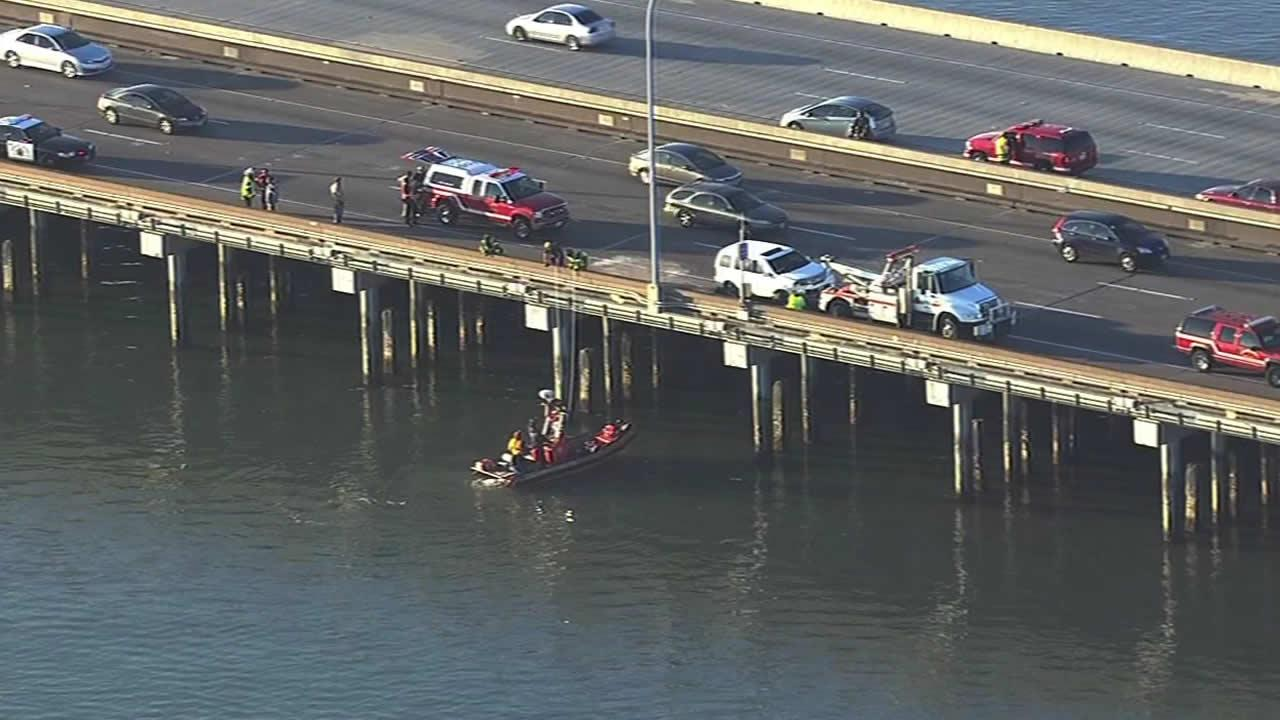 A Mill Valley man who fell into the Bay Friday is being accused of trying to throw his wife off of the San Mateo-Hayward Bridge.