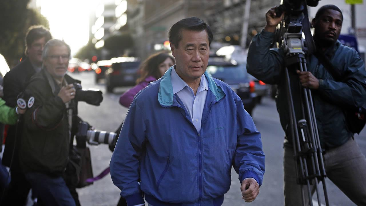 California Sen. Leland Yee, D-San Francisco, right, leaves the San Francisco Federal Building, Wednesday, March 26, 2014, in San Francisco. (AP Photo/Ben Margot)