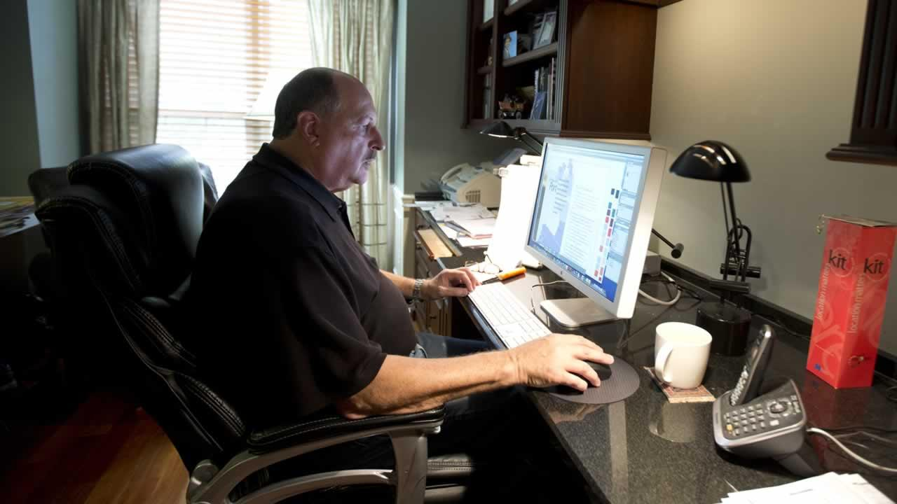 A man working in a home office.