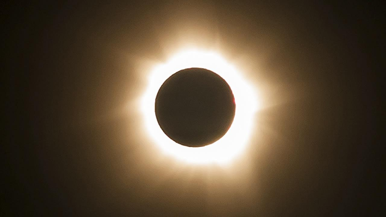 In this photo provided by Tourism Queensland, the moment of a total solar eclipse is observed at Cape Tribulation in Queensland state, Australia, Wednesday, Nov. 14, 2012.