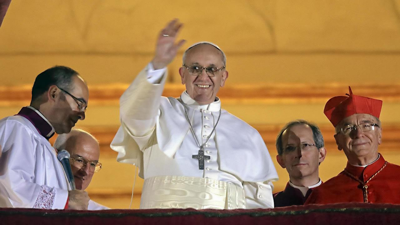 Pope Francis waves to the crowd from the central balcony of St. Peters Basilica at the Vatican, Wednesday, March 13, 2013. Cardinal Jorge Bergoglio, who chose the name of Francis is the 266th pontiff of the Roman Catholic Church