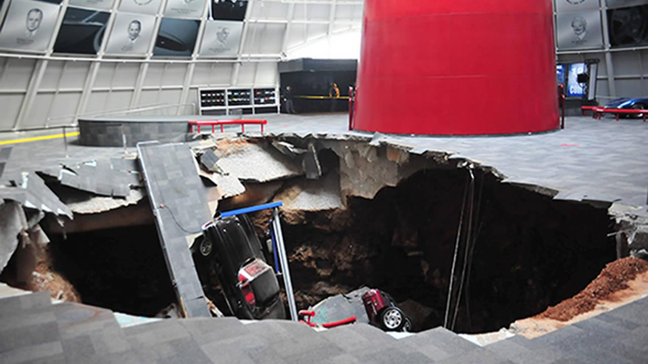 In this image provided by the National Corvette Museum shows several cars that collapsed into a sinkhole Wednesday, Feb. 12, 2014, in Bowling Green, Ky.