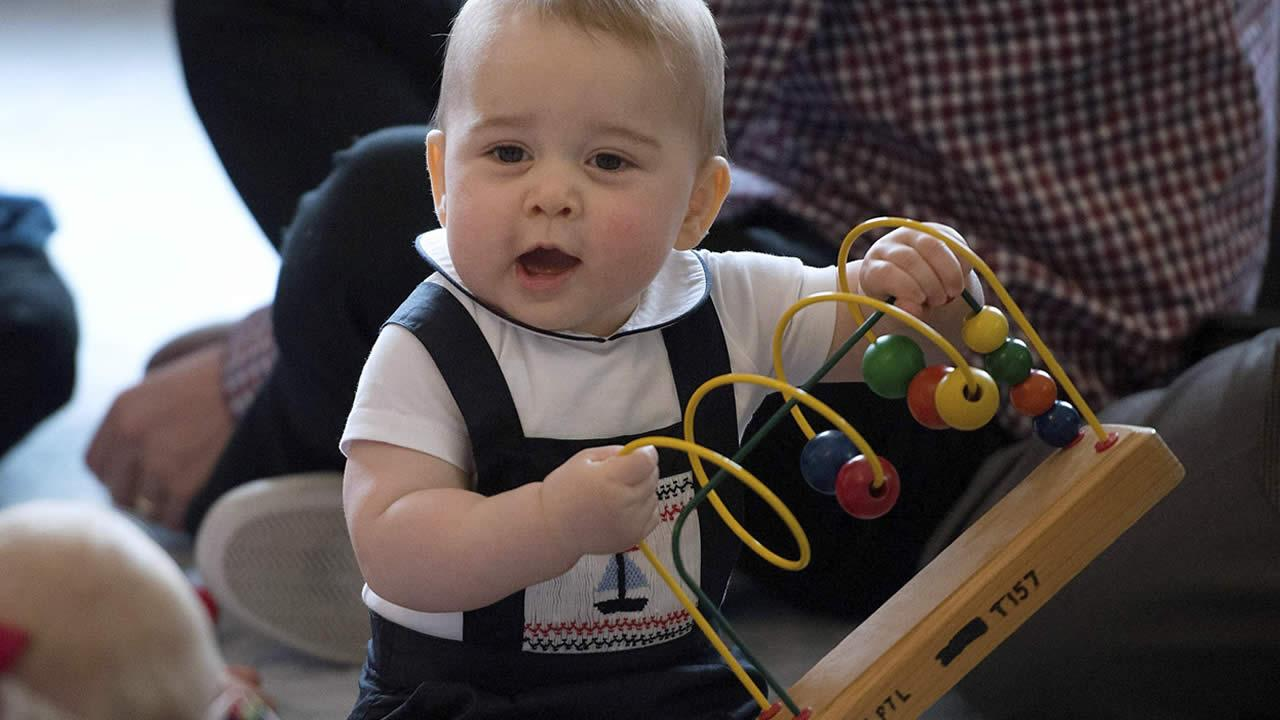 Britains Prince George plays during a visit to Plunket nurse and parents group at Government House in Wellington, New Zealand, Wednesday, April 9, 2014