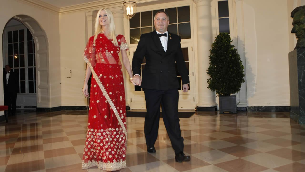 In this Tuesday, Nov. 24, 2009 photo, Michaele and Tareq Salahi, right, arrive at a state dinner hosted by President Barack Obama for Indian Prime Minister Manmohan Singh at the White House in Washington.
