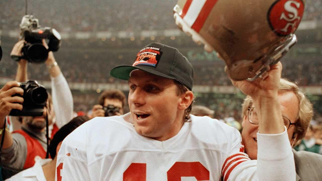 San Francisco 49ers quarterback Joe Montana raises his helmet toward the crowd as he leaves the field following the teams 55-10 victory over the Denver Broncos in the Super Bowl in New Orleans, La., Jan. 28, 1990.
