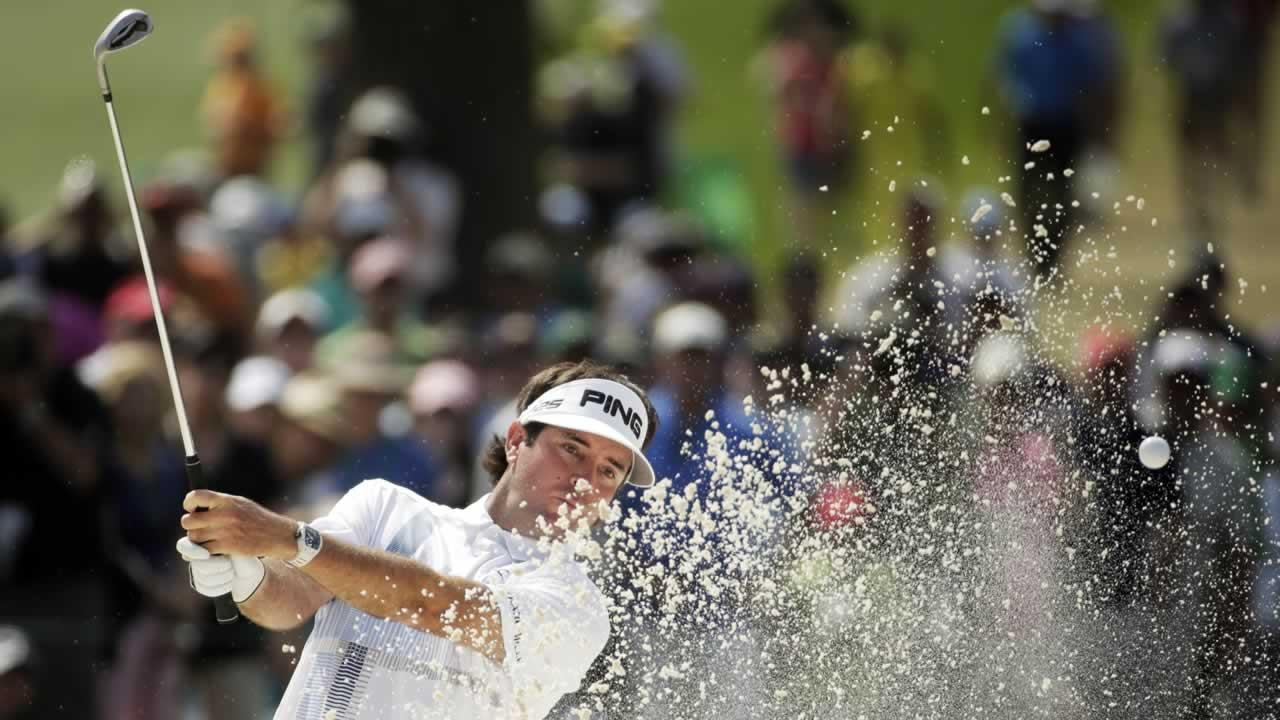 Bubba Watson hits out of a bunker on the seventh hole during the fourth round of the Masters golf tournament Sunday, April 13, 2014, in Augusta, Ga.
