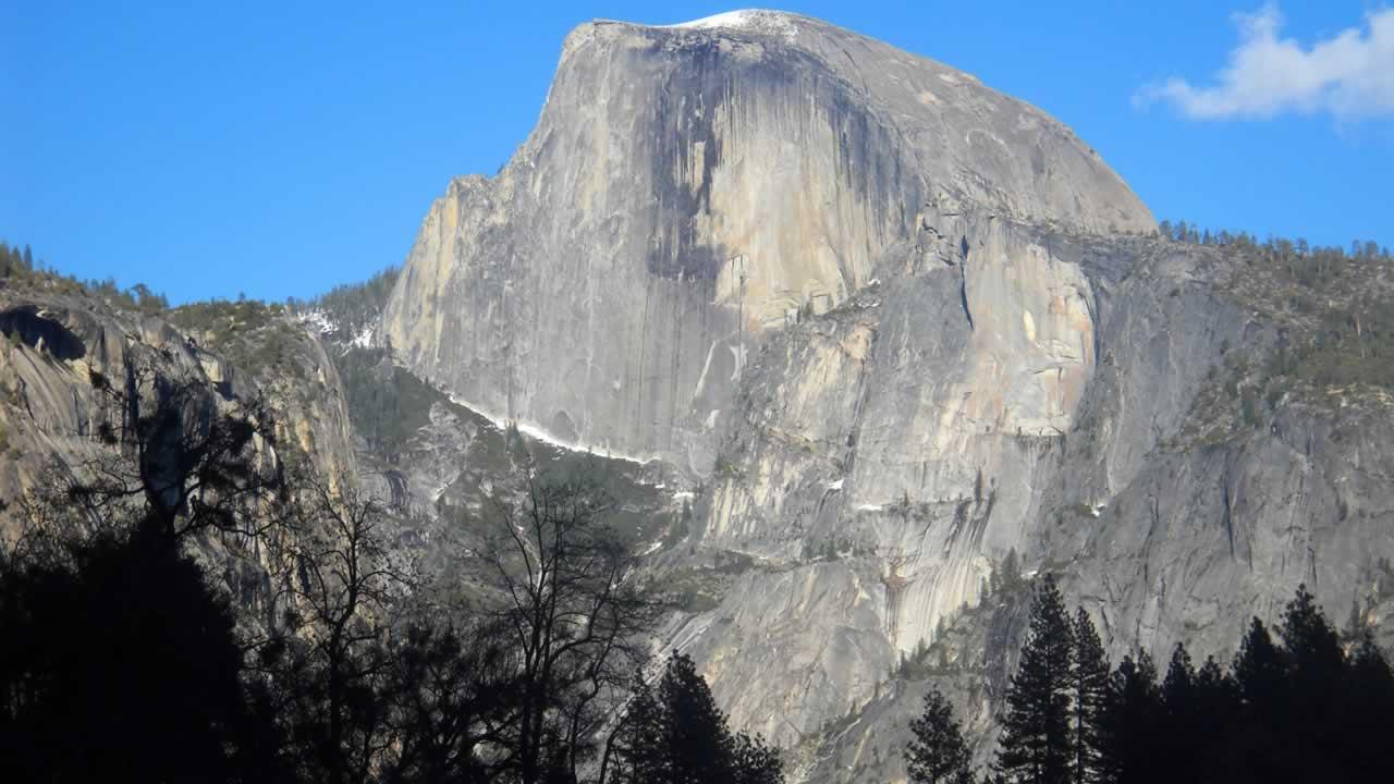 This April 2013 image shows Half Dome, the iconic granite peak in Yosemite National Park in California. Beautiful scenery, from mountain views to waterfalls, is easily accessible to visitors at Yosemite.