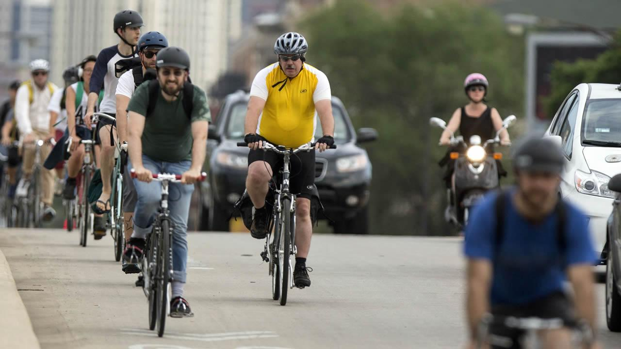 In this Tuesday, June 11, 2013 photo, cyclists ride on Milwaukee Avenue in Chicago