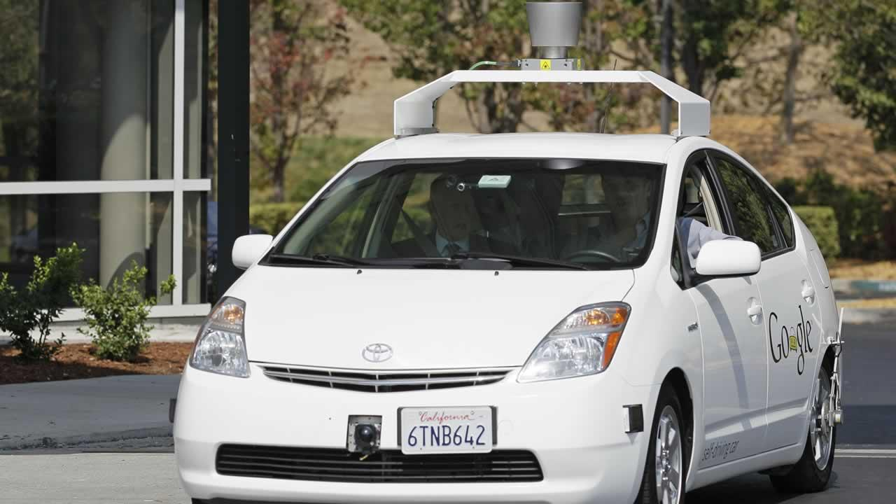 California Gov. Edmund G Brown Jr., front left, rides in a driverless car to a bill signing at Google headquarters in Mountain View, Calif., Tuesday, Sept. 25, 2012.
