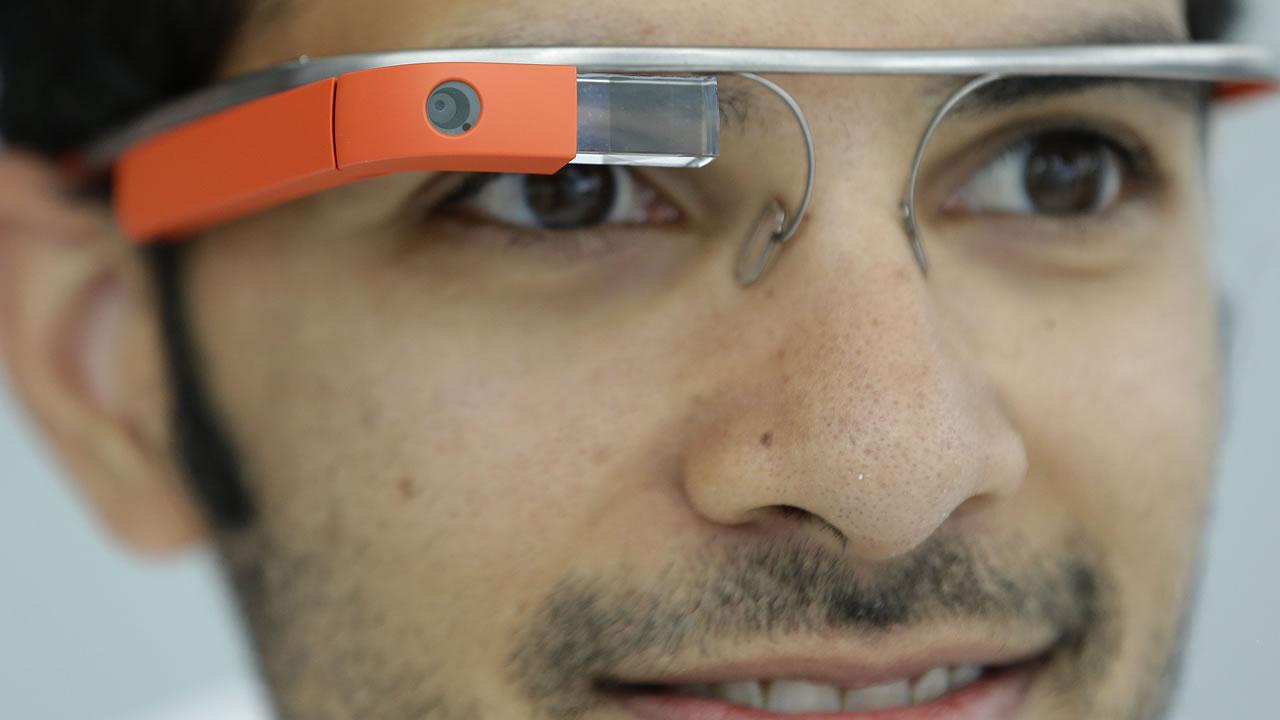 Google Glass team member Salil Pandit wears Google Glasses at a booth at Google I/O 2013 in San Francisco, Wednesday, May 15, 2013.