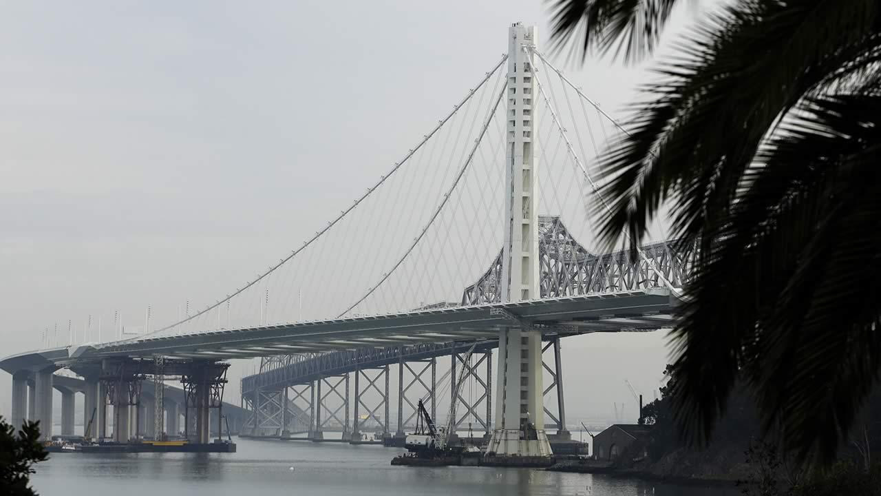 New eastern span of the San Francisco Oakland Bay Bridge, foreground, and the original span, background, Tuesday, Jan. 7, 2014, in San Francisco. (AP Photo/Ben Margot)