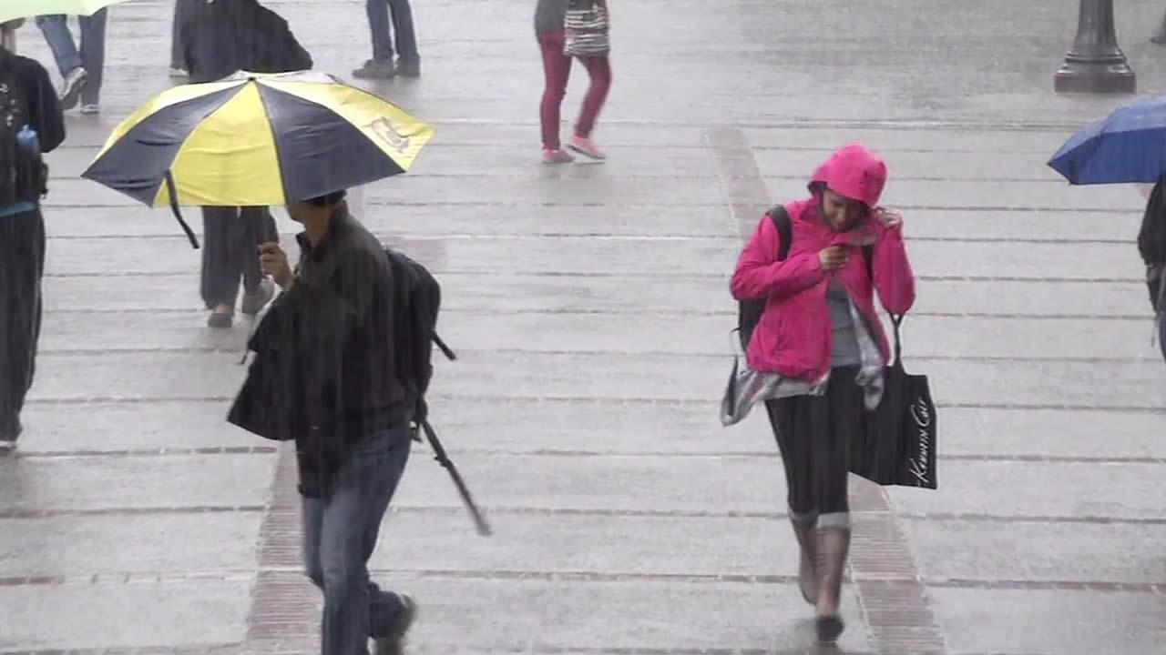 Cal students walk in the rain