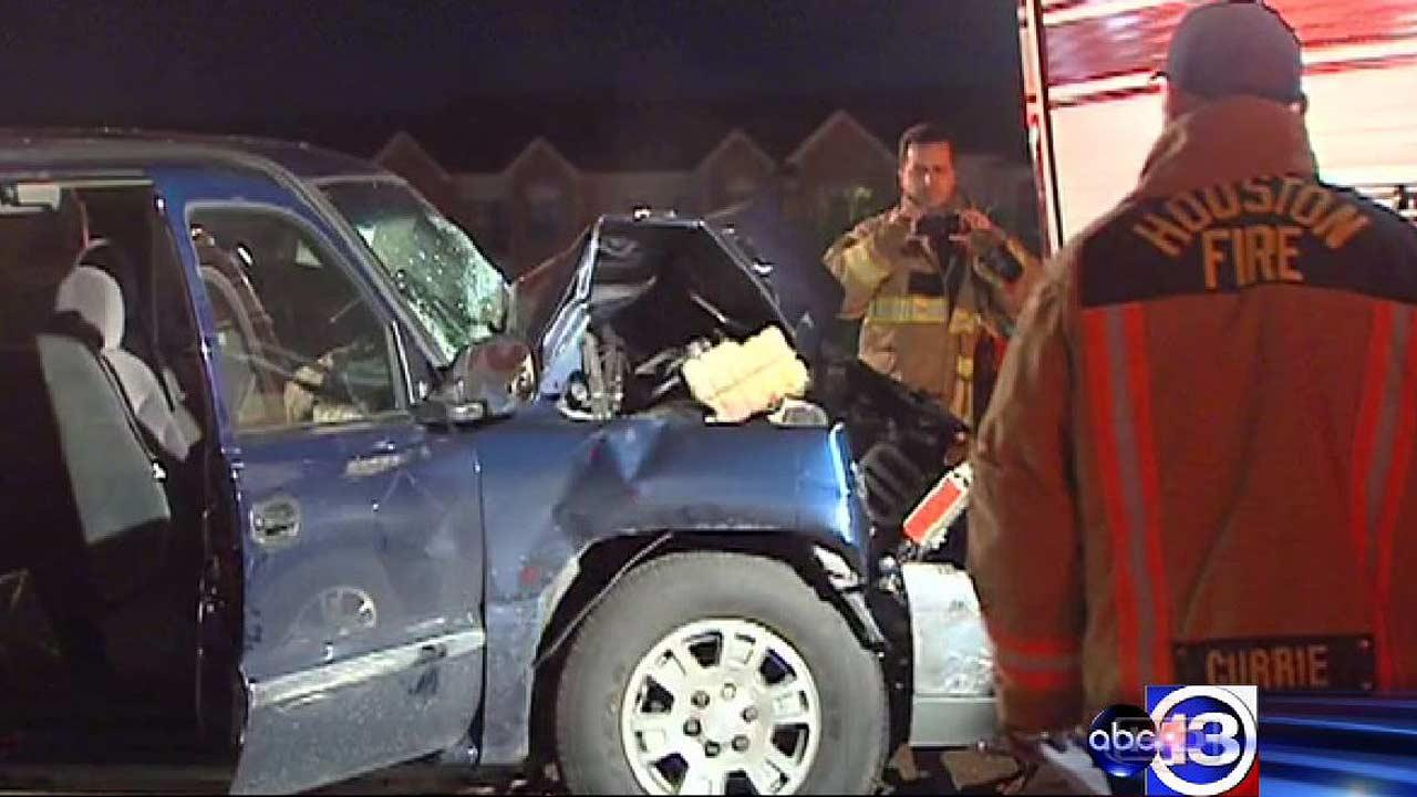 Investigators say the driver of this pickup was hospitalized after smashing into a Houston Fire Department engine