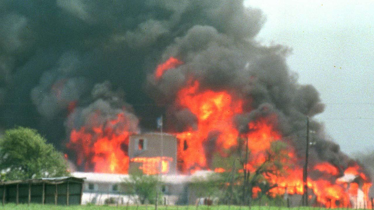 Fire engulfs the Branch Davidian compound near Waco, Texas, April 19, 1993. Eighty-one Davidians, including leader David Koresh, perished as federal agents tried to drive them out of the compound. A few weeks earlier four agents from the Bureau of Alcohol, Tobacco and Firearms were slain in a shootout at the site, and six cult members were found dead inside. (AP Photo/Ron Heflin)