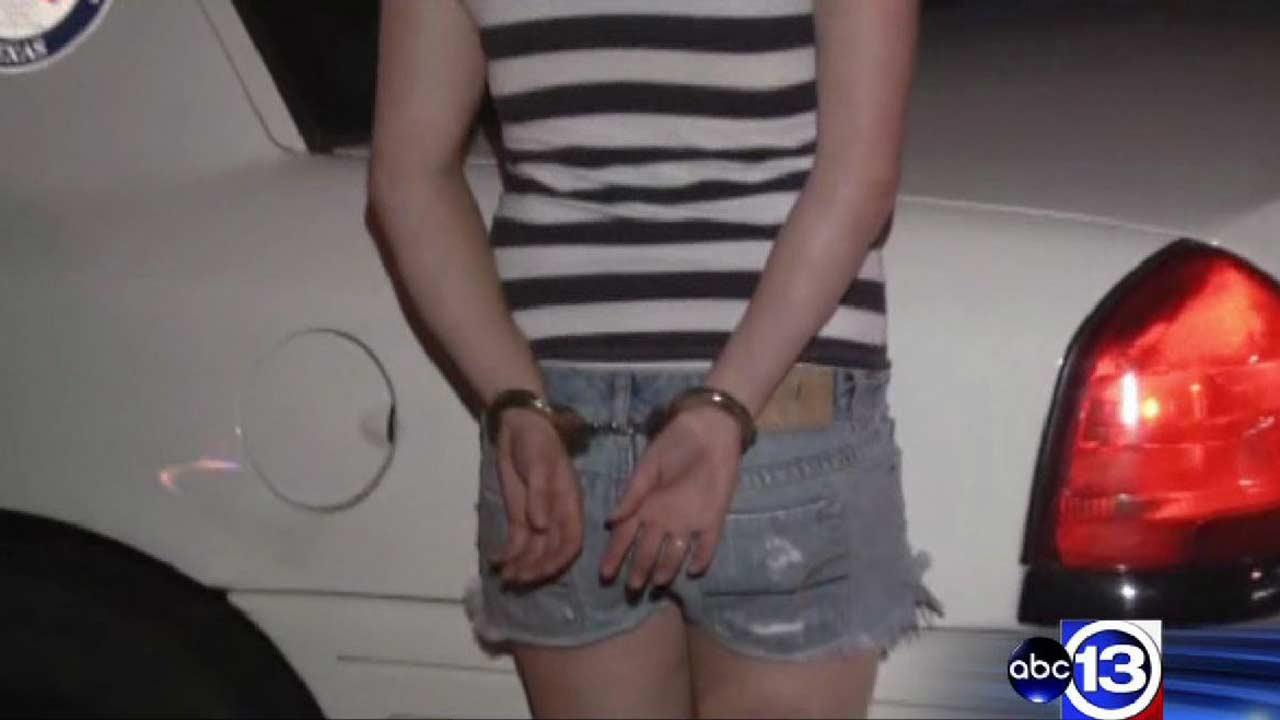 A woman is handcuffed along the North Freeway in Montgomery County where she and three others were all arrested for driving while intoxicated