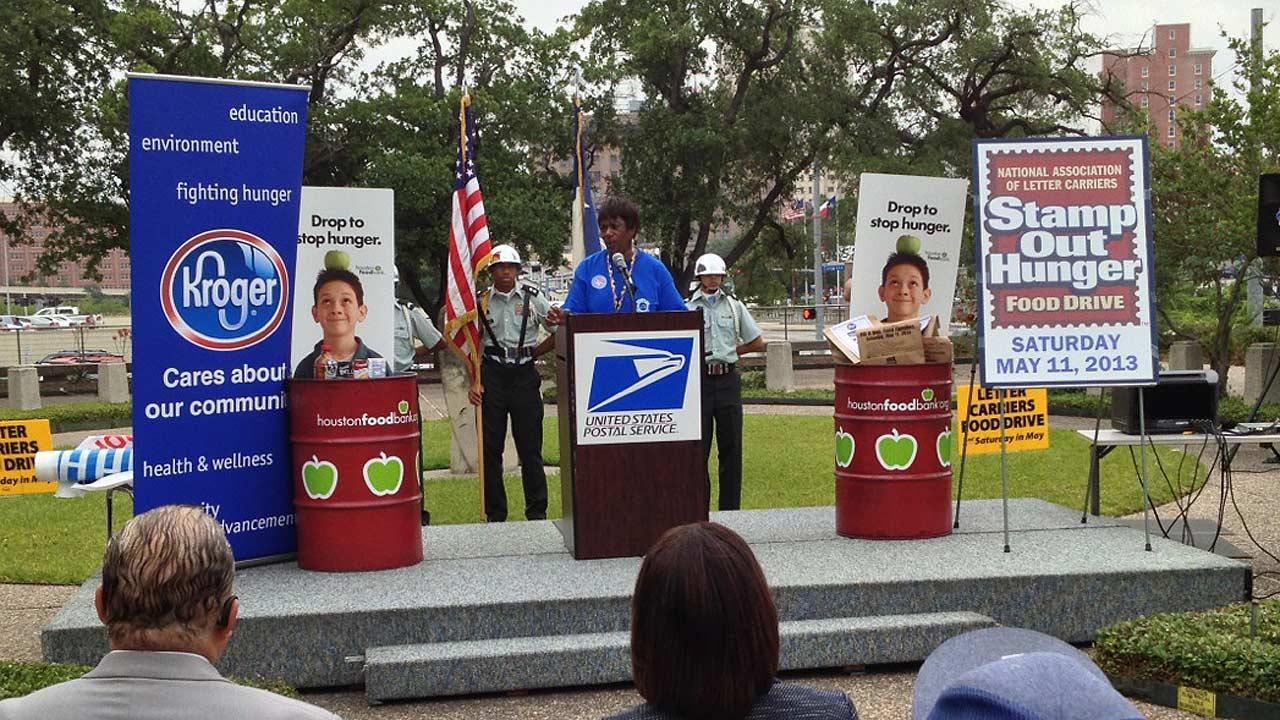 The mail carriers met at Houstons main post office to talk about the 21st annual Stamp Out Hunger Food Drive.