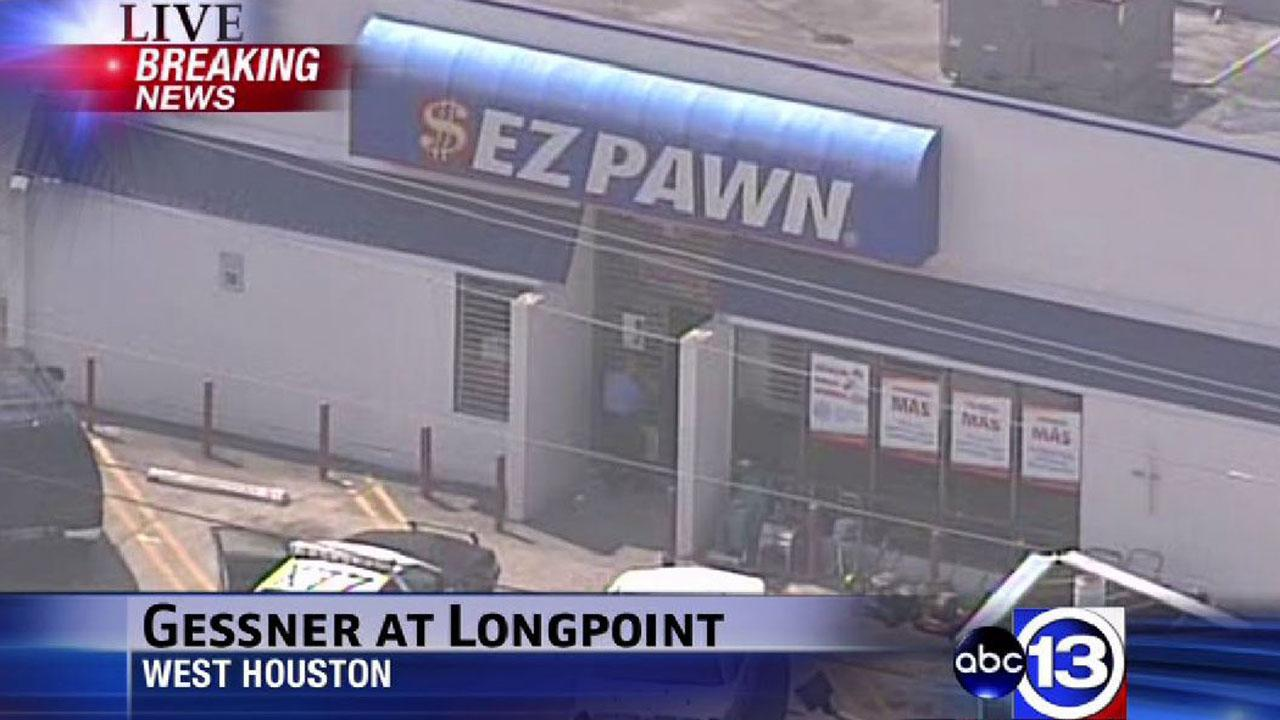 SkyEye13 HD was over the scene of an apparent robbery at west Houston pawn shop Tuesday morning