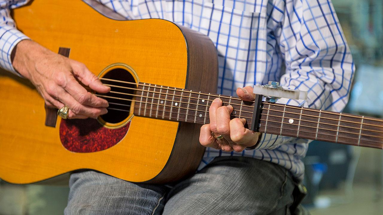A team of Rice University students has designed a new capo for guitars that improve ease and comfort of playing. (Photo courtesy of Rice University)