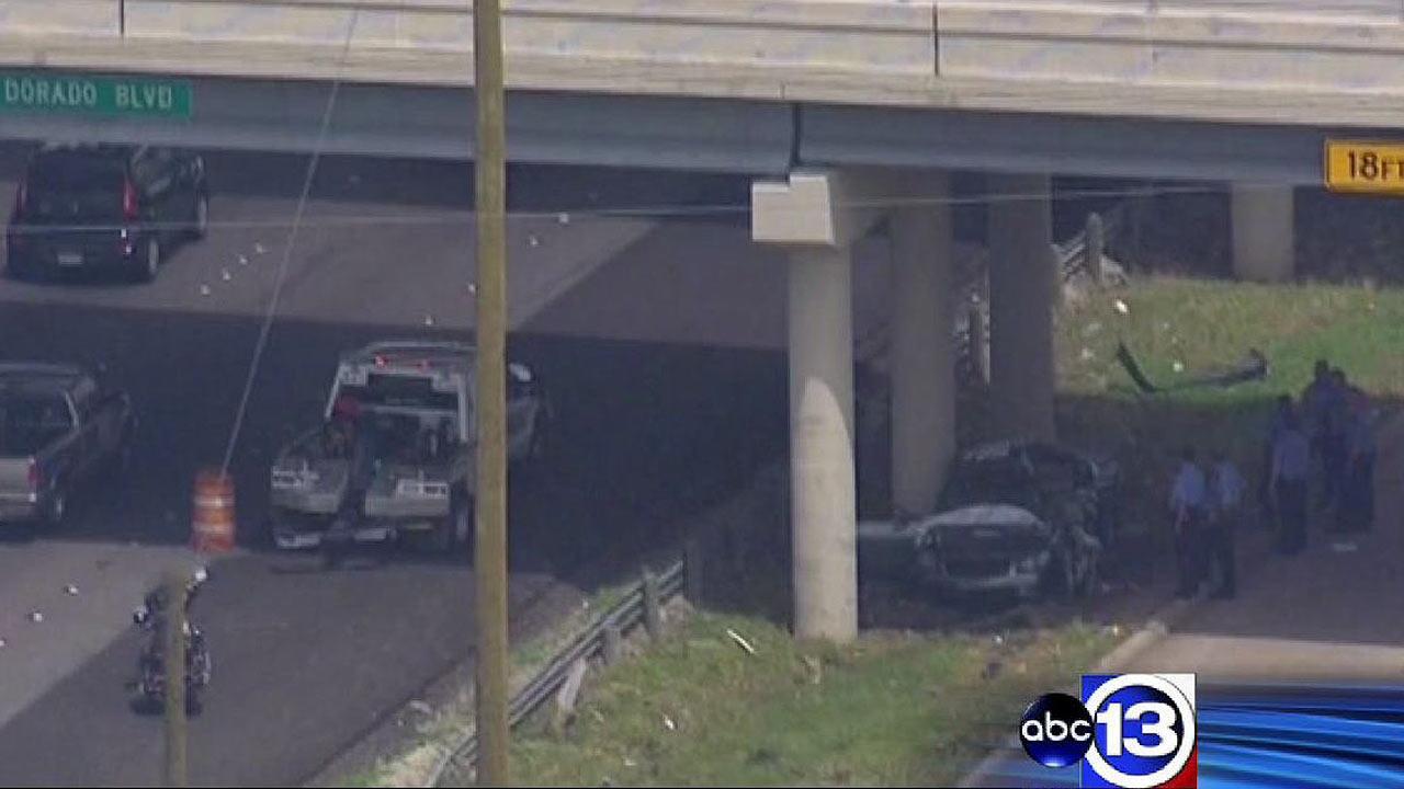 Vehicle slams into Gulf Freeway overpass pillars, killing woman and child
