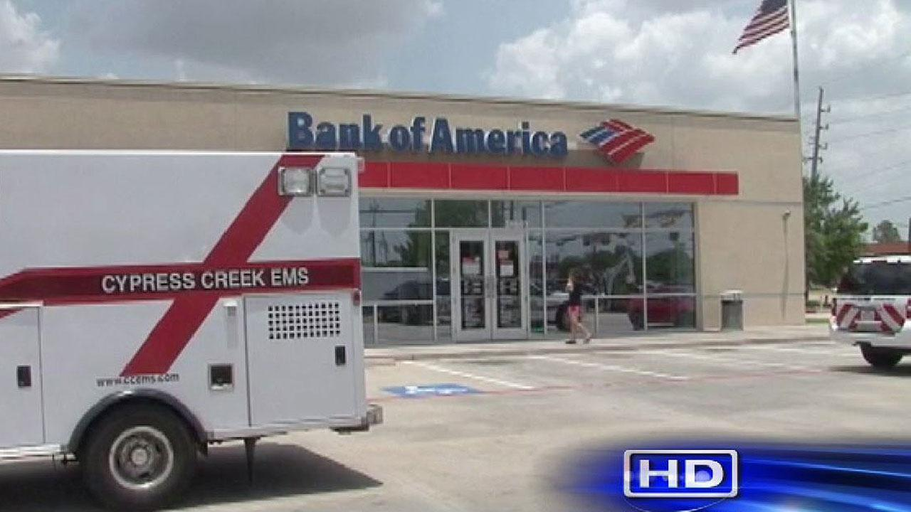 Deputies say three men pulled guns on people at a Bank of America on Louetta Thursday afternoon, and one customer had be taken to a hospital.