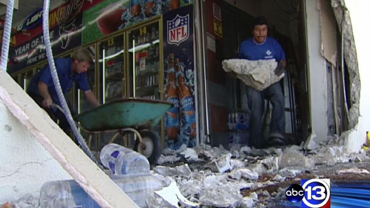 The owner of this Humble store is cleaning up after a vehicle crashed through the wall