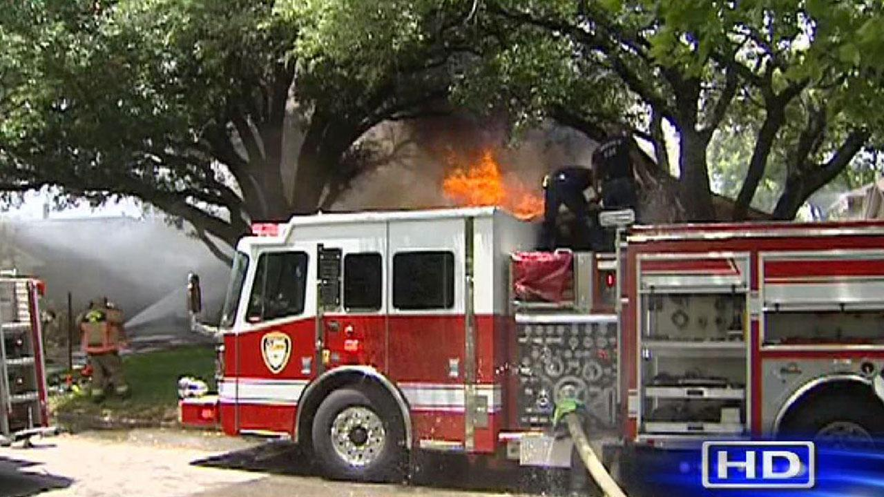 Firefighters at the scene of a house fire on Cheena in southwest Houston