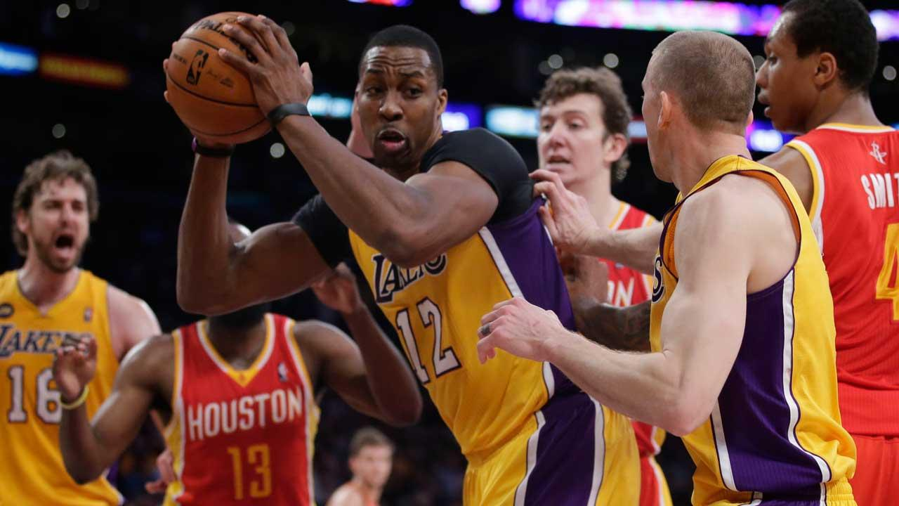 Dwight Howard is trading in the purple and gold for Rockets red  (AP photo)