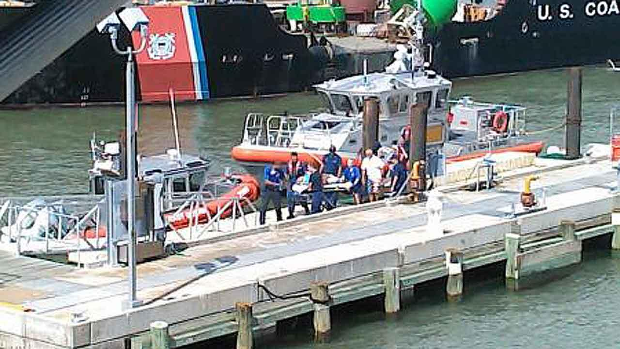 Crewmembers from Coast Guard Station Galveston transport a medevaced victim to Emergency Medical Services, July 6, 2013.