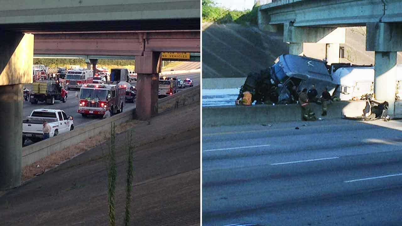 An overturned 18-wheeler (right) on the 610 East Loop northbound at Clinton had all lanes of traffic blocked -- northbound and southbound -- for hours Saturday, and officials say the truck spilled fuel