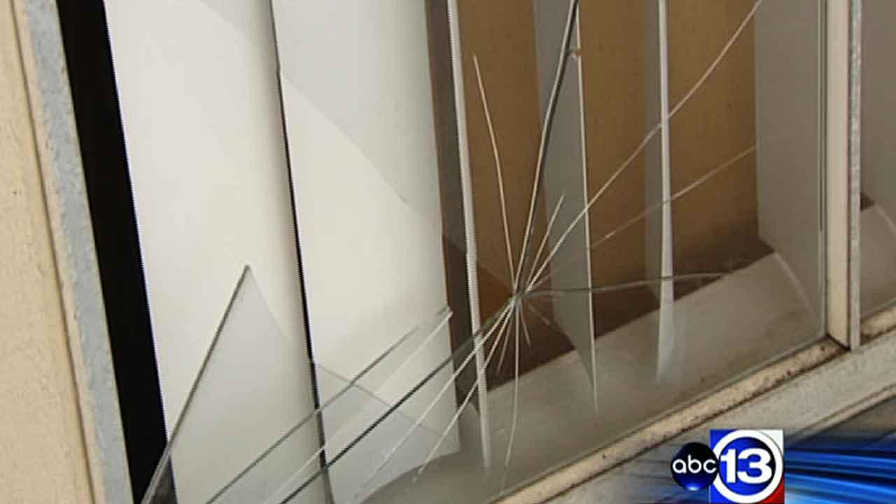 A broken window outside a Pasadena apartment where a woman was murdered