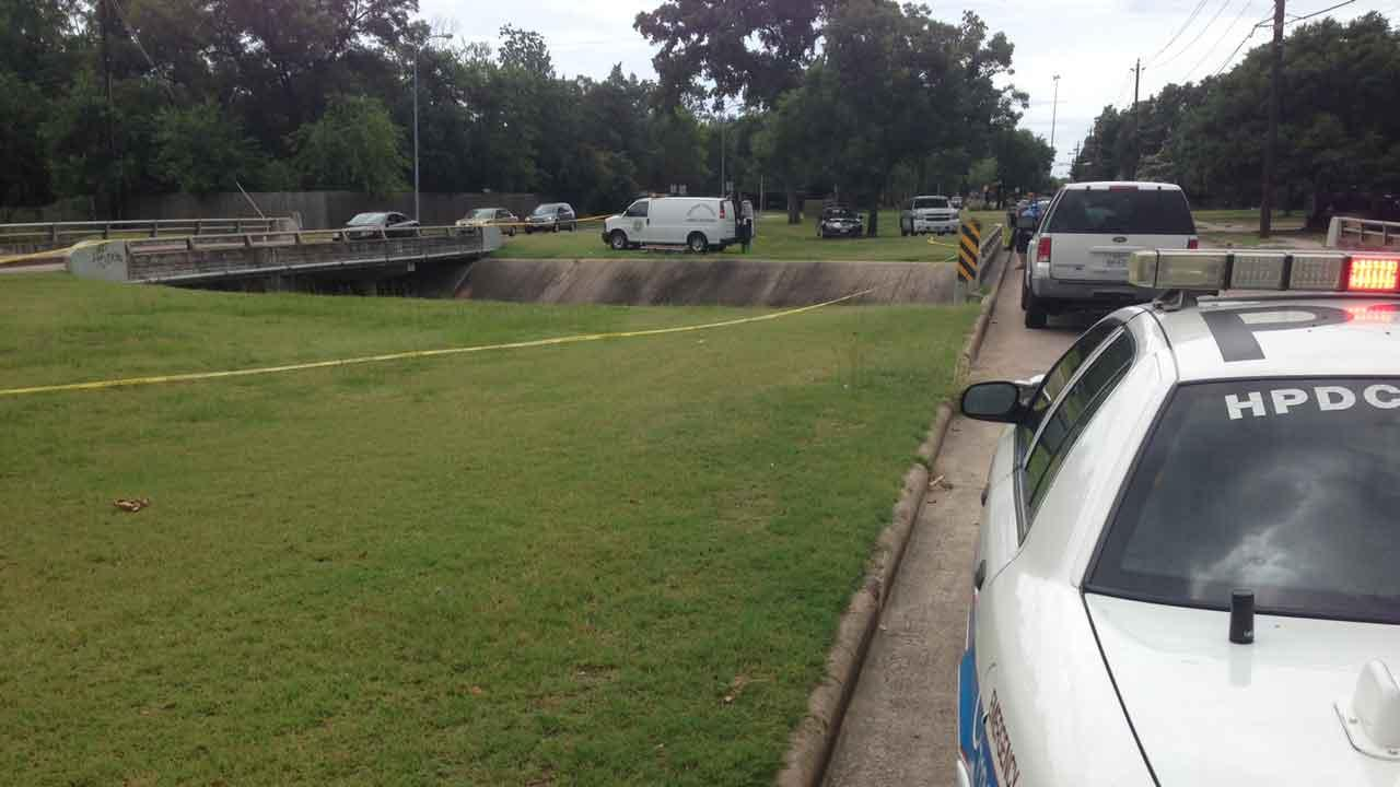 Investigators surround a northwest Houston bayou where a body was found Sunday morning