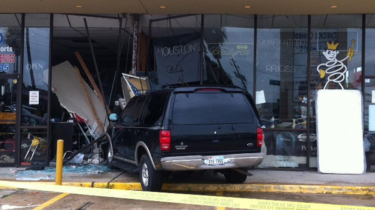A Ford Explorer crashed into Southwest Mattress and Texotic Motorsport