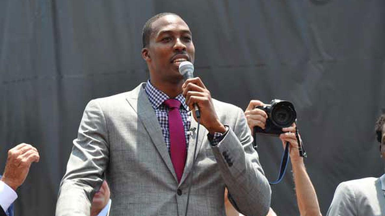 Dwight Howard speaks outside Toyota Center in Houston on Saturday, July 13, 2013. The Houston Rockets hosted a Red Rally downtown where fans braved the heat to welcome Howard to the team and to the city.